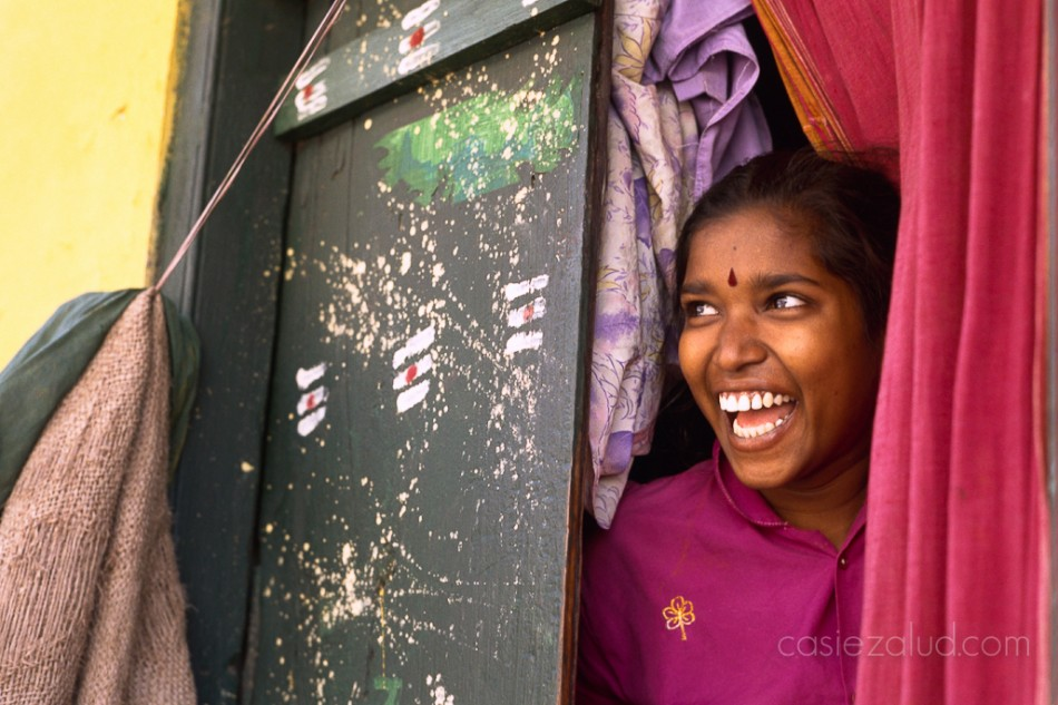 Indian woman with colorful door