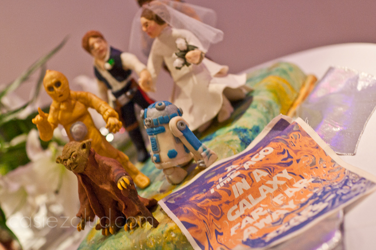 Star Wars themed grooms cake with figures made of chocolate : Yoda, C3PO R2D2, Luke, Princess Leah in a veil and Chew Backa