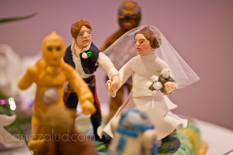 close up image of Luke and Princess Leah figures made of chocolate on a groom's cake