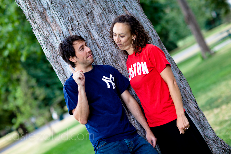 engaged couple: guy wearing Yankees shirt saying Yankees are number one, girl wearing Boston t-shirt saying no way