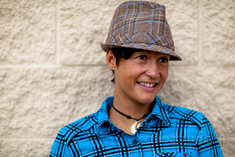 head shot of a woman in color with plaid hat and plaid shirt that do not match