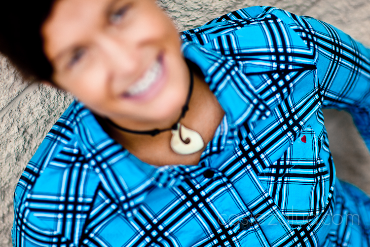 blurred portrait of a woman from above, her plaid shirt has a small heart on the pocket, that is what is in focus and the rest of the shot is blurred