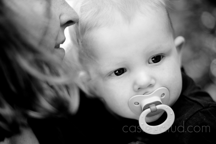 close up of a 12 month old and the edge of his mom's face in black and white