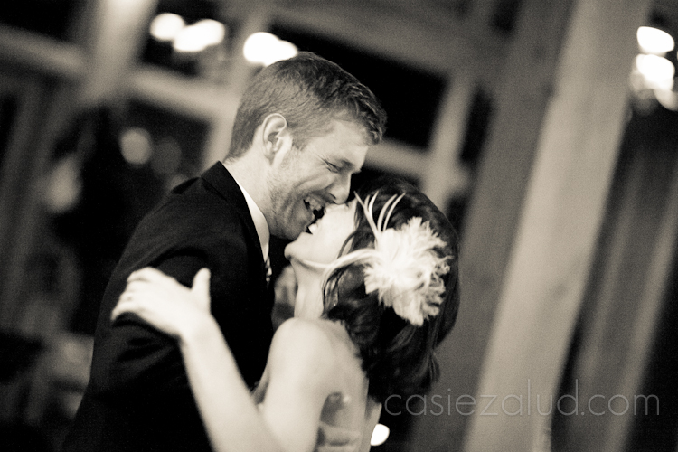 bride and groom dancing their first dance and laughing hystically