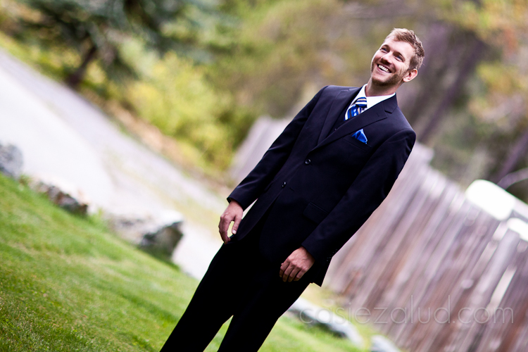 groom standing outside, waiting for his bride with excitement