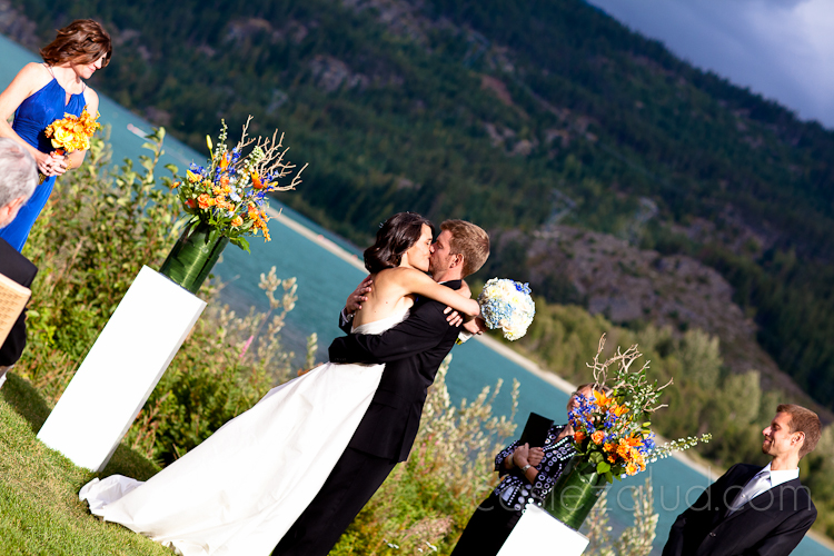 a bride and groom kissing after being married
