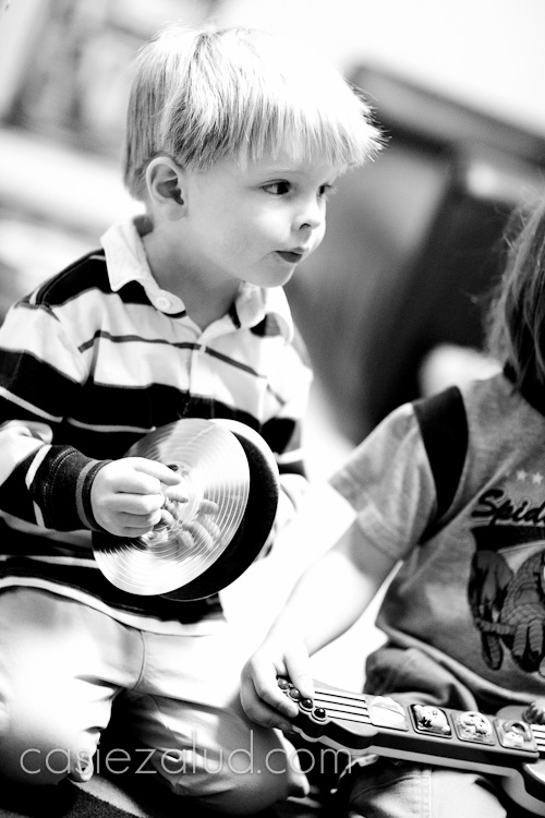 3 year old boy playing the symbols in black and white
