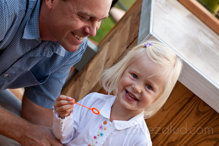 two year old and her father blowing bubbles