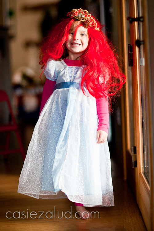 two and half year old girl dressed as Princess Ariel for Halloween