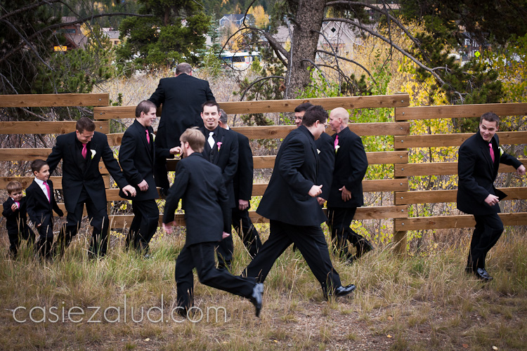 groom standing in the center and his thriteen groom's men running around him