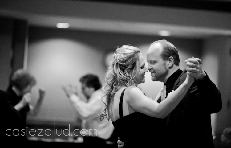 couple in love dancing at a wedding looking eye to eye