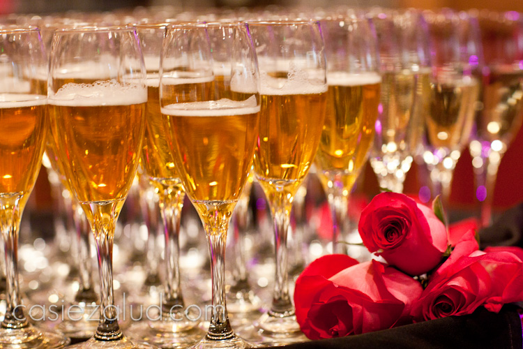 champagne glasses with three pink roses