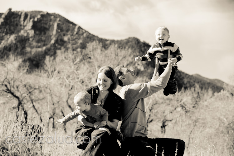 family portraits infront of mountains in black and white