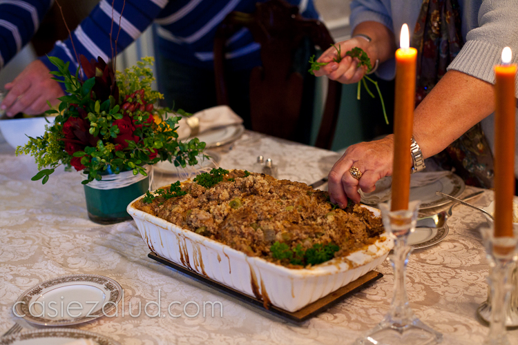 A cassarole pan of stuffing sitting on the table.