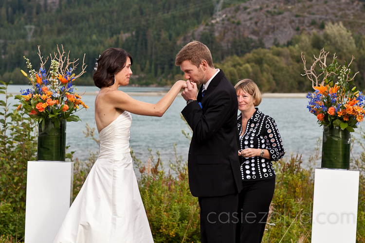 groom kissing the bride's hand after saying his vows to her