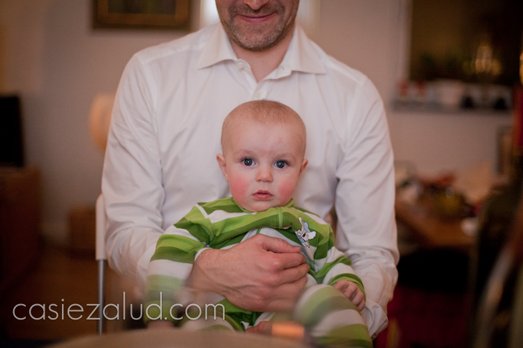 a Swedish child sitting on Dad's lap, looking directly at the camera