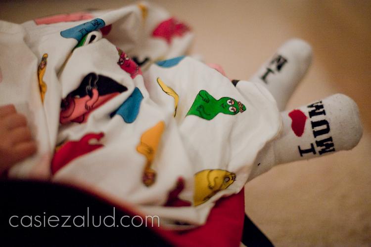 "Swedish child wearing socks that say ""I 'heart' Mum"""
