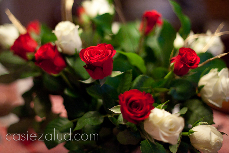 close up image of a bouquet of red and white roses