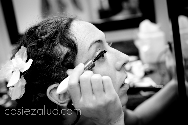 bride applying her own mascara