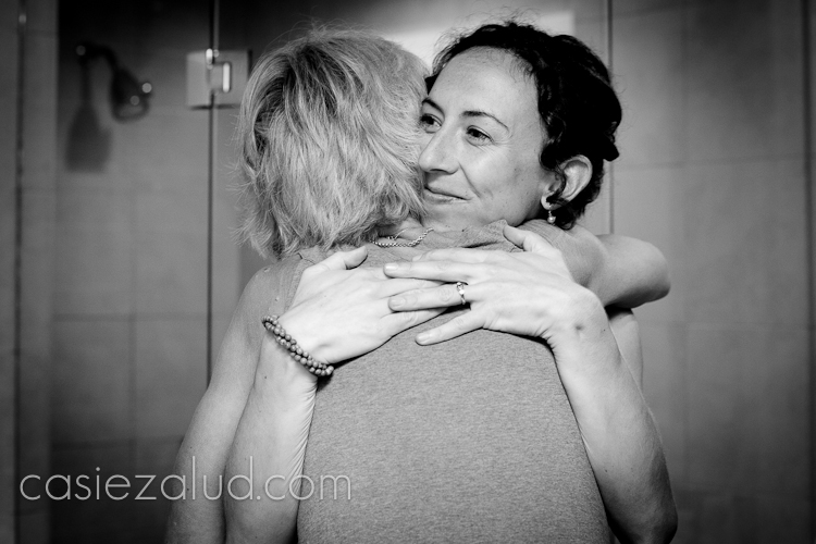 mom and bride hugging
