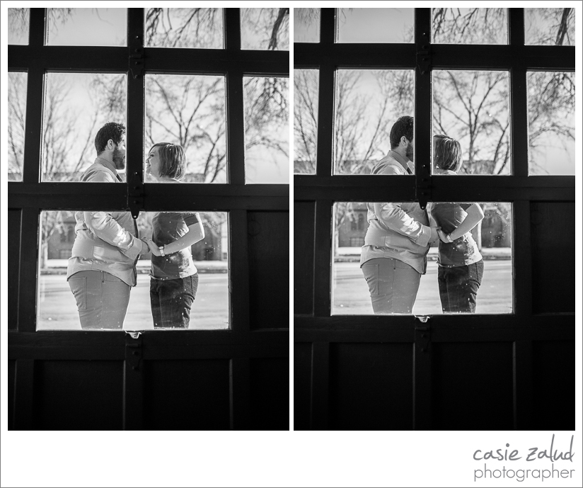 Intimate kiss of engaged couple through a window