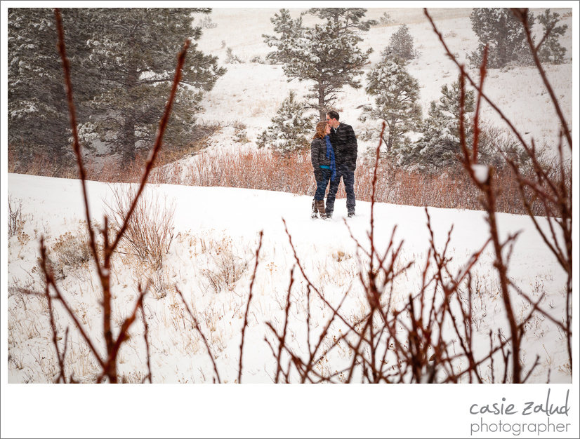 engaged couple kissing in a blizzard in Boulder