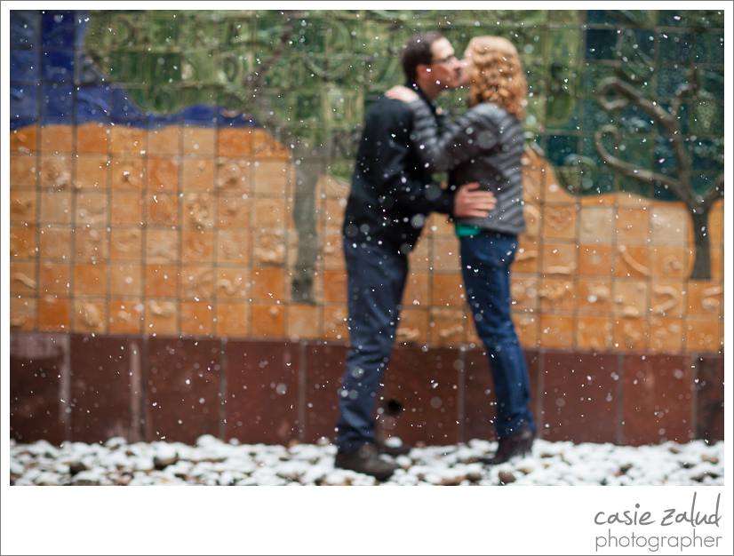 Engagement session in the snow outside the Boulder library