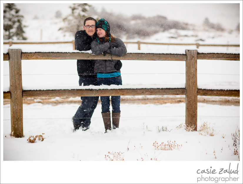 Engaged couple at Marshall Mesa trail in a snowstorm