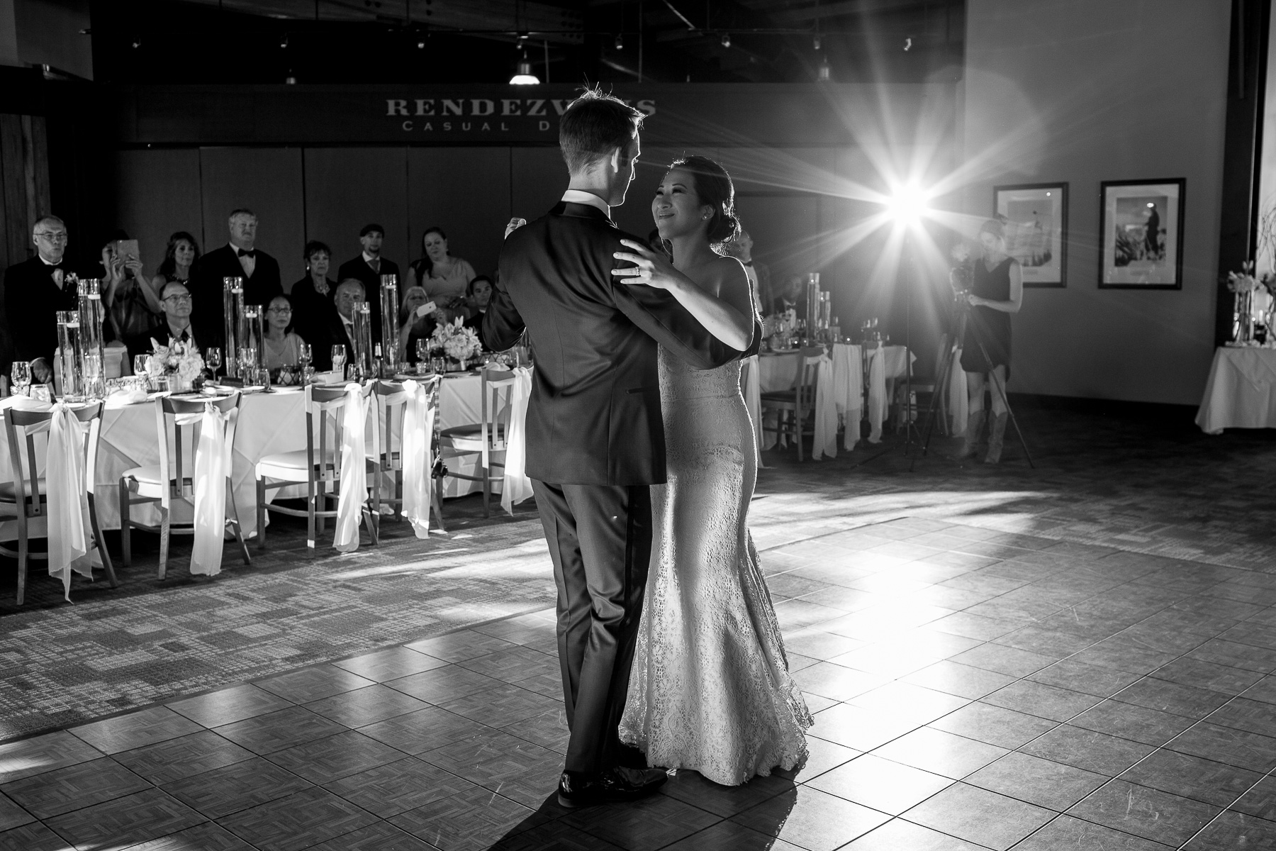 BW bride and groom first dance as their guests watch