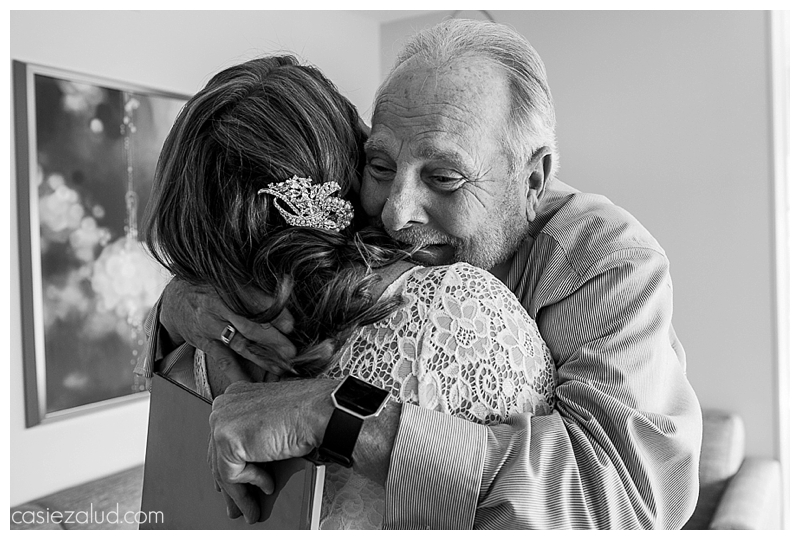 Emotional father hugging his daughter just before her wedding