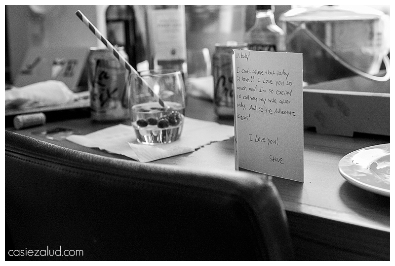 A card opened just enough to see the words from a groom written to his bride on her wedding day in BW
