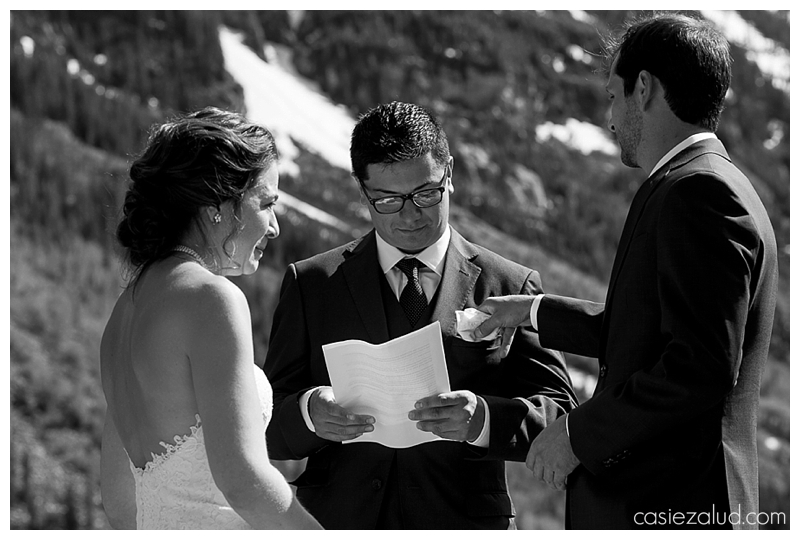 groom tucking the officiant's pocket square into his pocket after wiping a tear from his bride's eyes during a Maroon Bells Wedding
