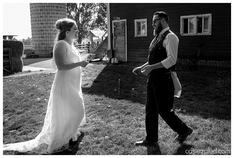 bride and groom walking towards each other on a farm as they see each other for the first time