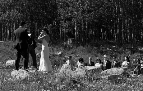 bride wiping tear from face at Maroon Bells wedding