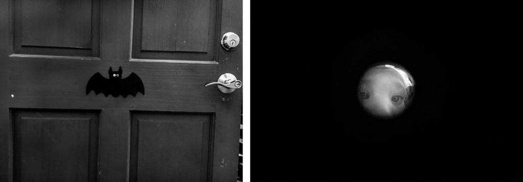 BW of a door with a bat and girl looking through peep hole
