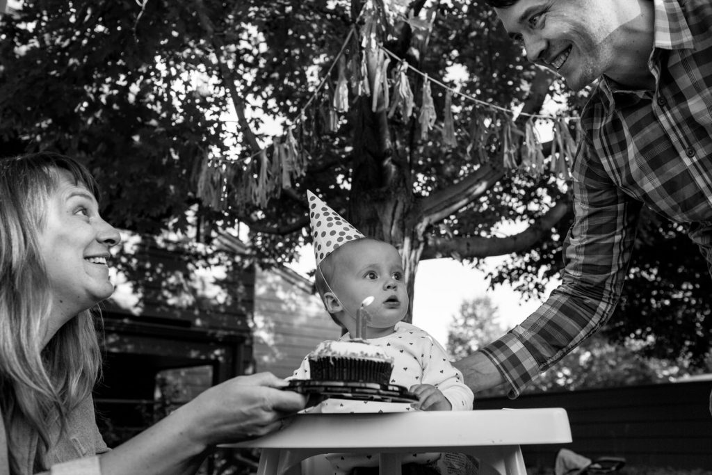 first birthday party with cake and happy parents