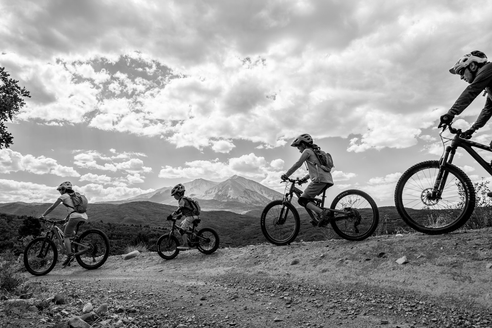 Family of four biking in aspen colorado. Black and White silhouette