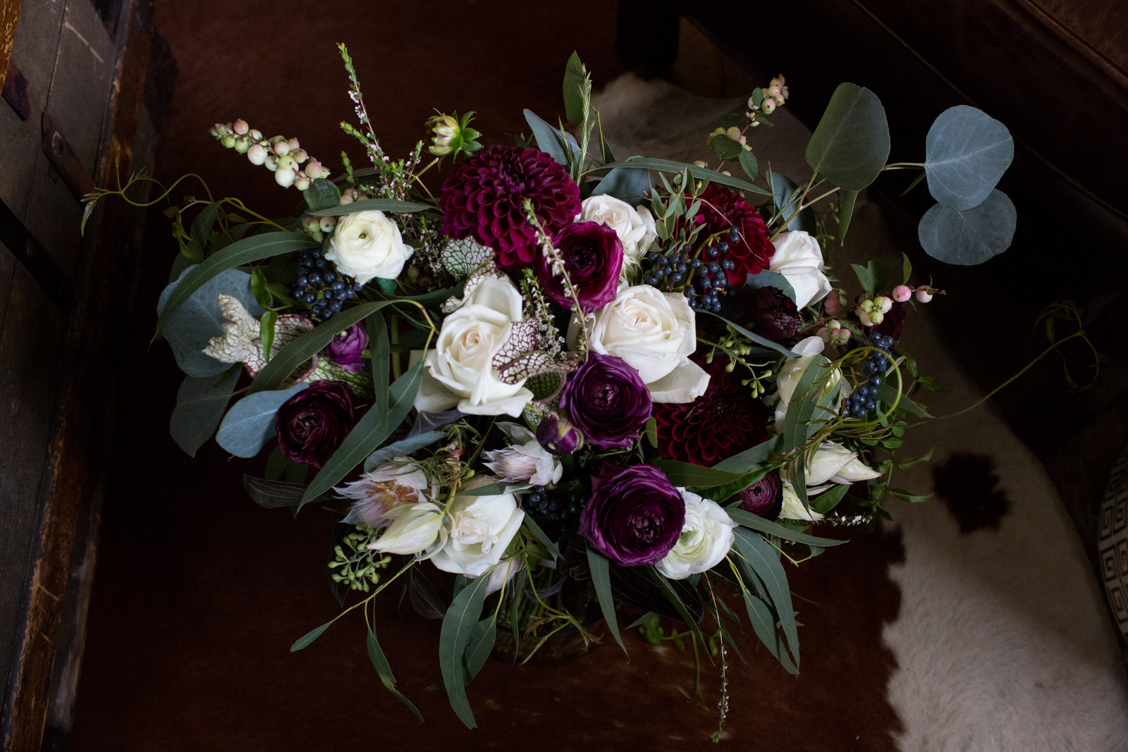 burgundy and off white bridal bouquet with greenery and dark berries