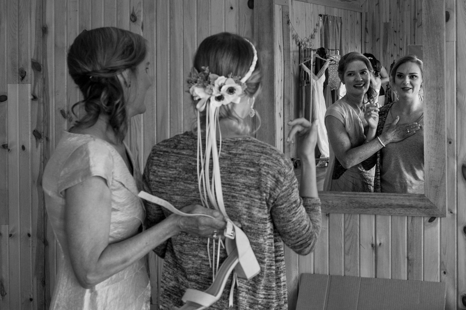 black and white of the mother of the bride and bride sharing a moment the the mirror at lone hawk farm as they get ready for the wedding