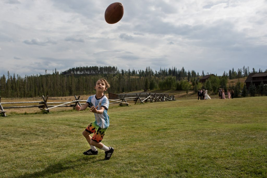 kid just about to catch a football