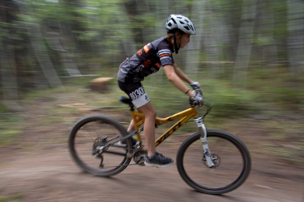 teenage boy downhill mountain biking during colorado vacation